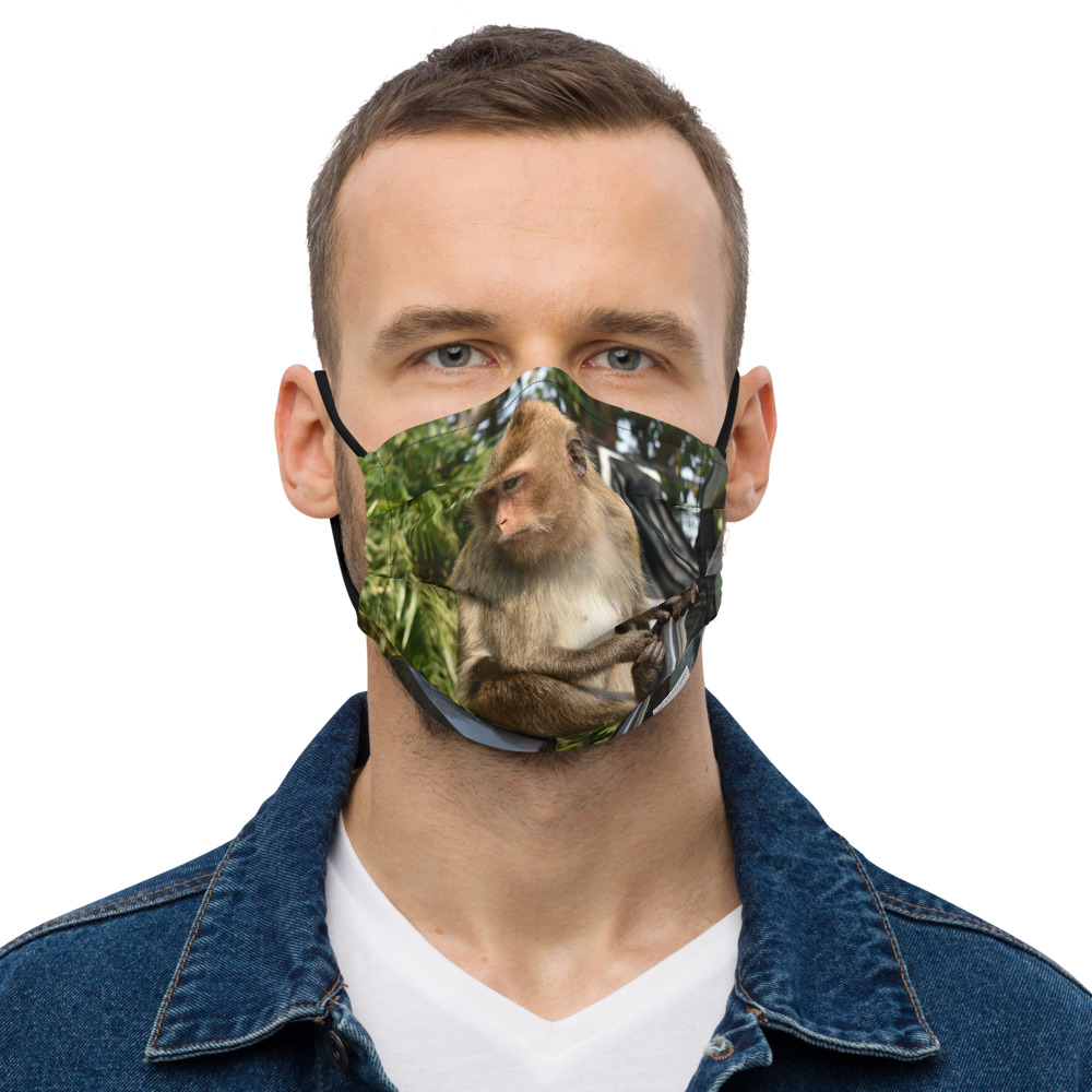 man wearing reusable face mask with monkey print